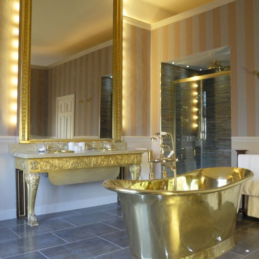 Brass Bateau Bath with Brass Interior